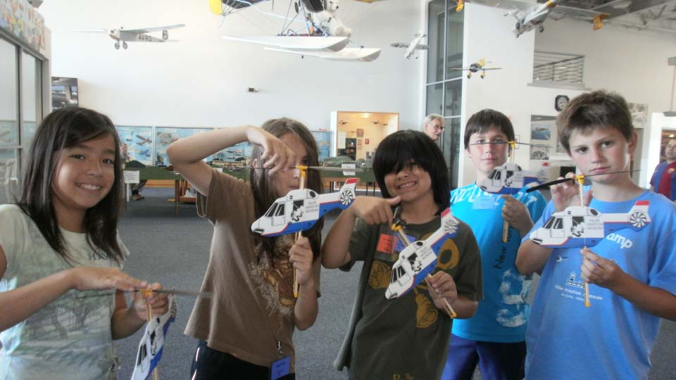 Campers testing styrofoam helicopters.