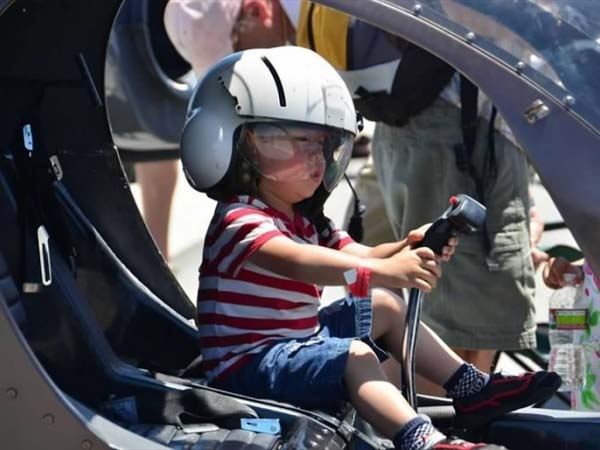 Toddler at Helicopter Controls